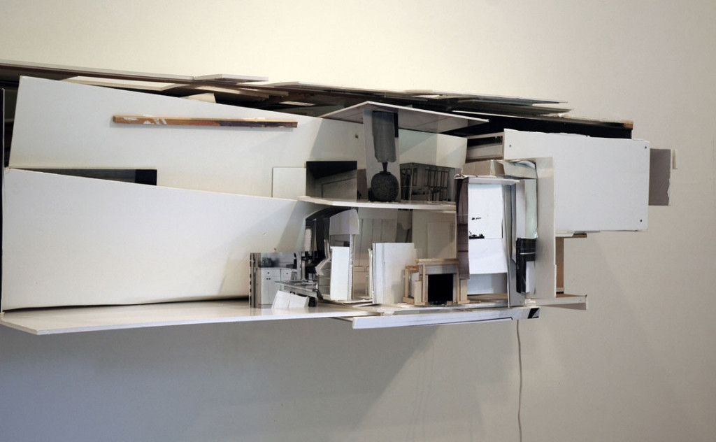 """Salvaged # 11, 144"""" X 56"""" X 54"""", paper, cardboard, foam core, photographs, wood, electric lamp, 2006."""